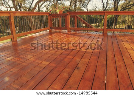 Newly Stained Deck in Backyard - stock photo