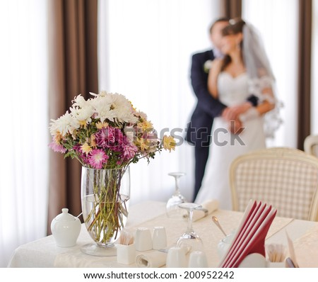 Newly wed couple in cafe. Groom and bride together. - stock photo