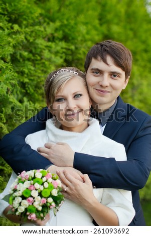 newly-weds smile, romantic happy newlywed couple embracing each other,happy married couple on nature,Beautiful wedding couple,romantic moment on your wedding day,portrait of the bride and groom     - stock photo