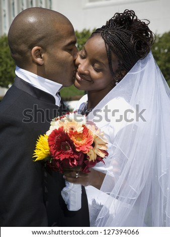 Newlywed african american couple kissing and smiling - stock photo