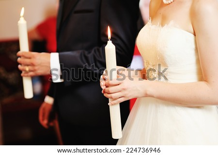 Newlywed couple in church. - stock photo