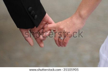 Newlywed couple on their wedding day together. - stock photo
