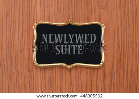 Newlywed Suite Sign Wood Grain Door Close Up