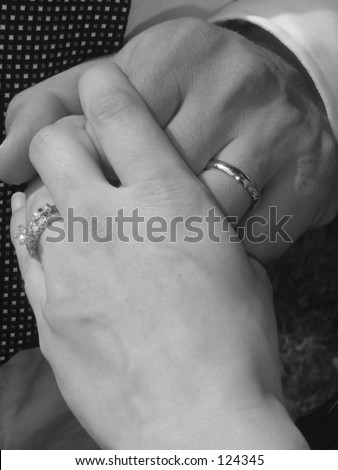 Newlyweds holding hands black & white