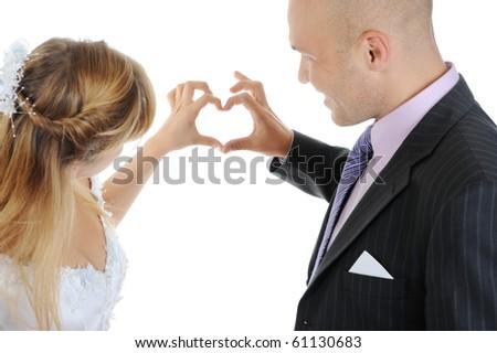 Newlyweds make heart fingers. Isolated on white - stock photo