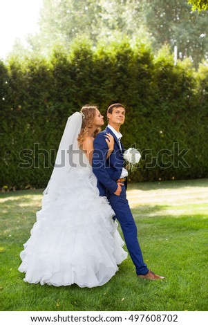 Newlyweds on a walk in the park on a warm sunny day