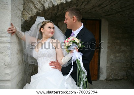 Newlyweds on the background of a beautiful old castle, a beautiful spring day