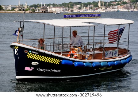 Newport, Rhode Island - July 17, 2015:  A Vineyard Vines Newport Harbor Shuttle Taxi on Narragansett Bay arriving at Fort Adams State Park