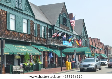 NEWPORT, RHODE ISLAND - JULY 19: Downtown Newport in Rhode Island as seen on July 19, 2013. Newport now contains among the highest number of surviving colonial buildings of any city in the USA. - stock photo