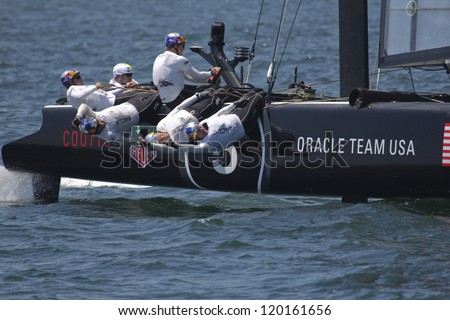 NEWPORT, RI - JULY 30: Russell Coutts skippers Oracle Racing during 2012 America's Cup World Series Time Trials in Newport, RI on June 30, 2012. - stock photo