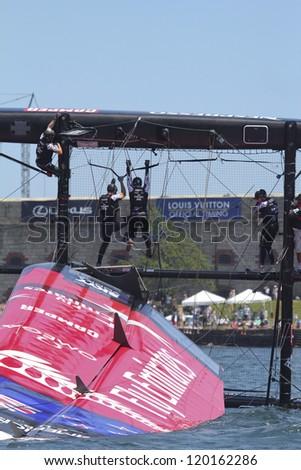 NEWPORT, RI - JUNE 28: Team New Zealand capsizes during 2012 America's Cup World Series in Newport, RI on June 28, 2012. - stock photo