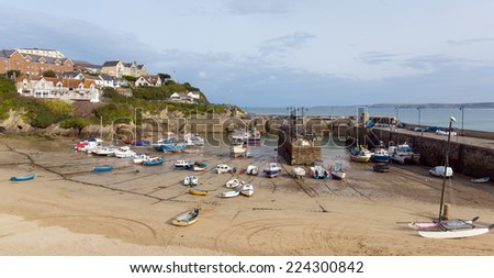 Newquay harbour North Cornwall England UK with boats at low tide - stock photo