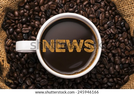 news. coffee mugh with coffee background - stock photo