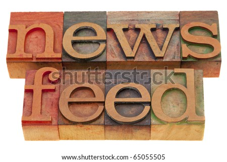 news feed words - vintage wooden letterpress blocks isolated on white