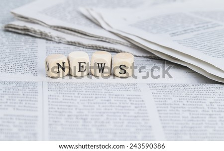 News formed by wooden letters, on top of newspapers - stock photo