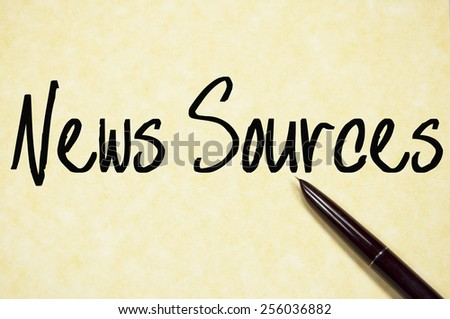 news sources text write on paper  - stock photo