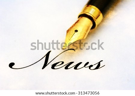 News text and fountain pen - stock photo