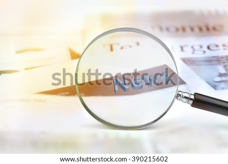 News through magnifying glass. - stock photo
