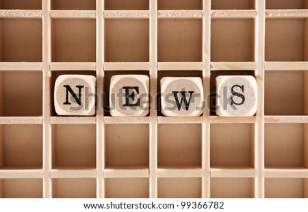 News word construction with letter blocks / cubes and a shallow depth of field - stock photo