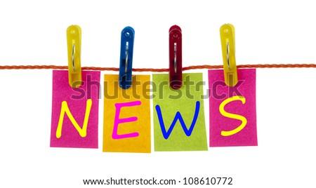 News word on laundry hook on white - stock photo