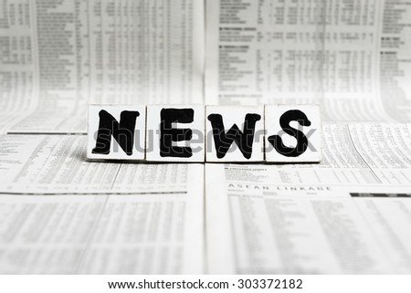 NEWS word on newspaper - stock photo