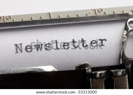 Newsletter written on an old typewriter - stock photo
