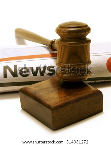 Newspaper and gavel for many legal issues in the current trends.