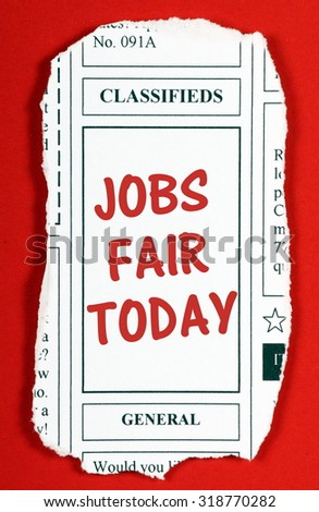 Newspaper clipping from the classified advertising section with the phrase Jobs Fair Today in red text  - stock photo