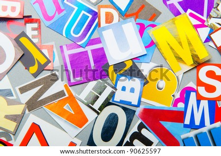 Newspaper clippings with various letters - stock photo