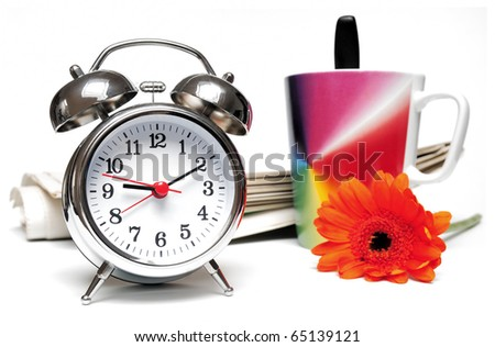 Newspaper, clock, cup of coffee and red daisy on white background - stock photo