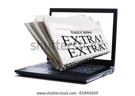 Newspaper coming through a laptop screen - concept for online news - stock photo