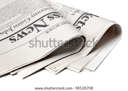 Newspaper detail on white background with shallow depth of field