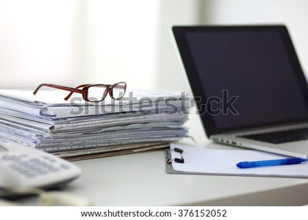 newspaper,eyeglasses, cup and laptop - stock photo