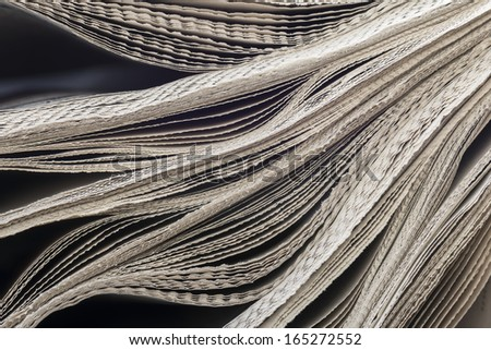 Newspaper of the wave pattern. - stock photo