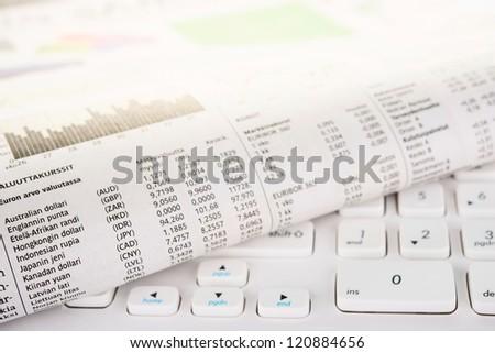 Newspaper on a white keyboard - stock photo