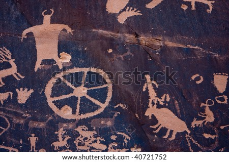 Newspaper Rock State Historic Monument features a flat rock with one of the largest known collections of petroglyphs. - stock photo