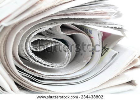 newspaper roll isolated on white background