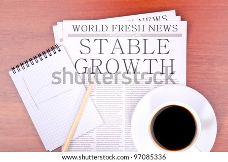 Newspaper STABLE GROWTH top view - stock photo
