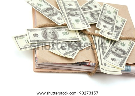 newspaper stack and dollars isolated on white background