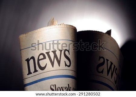 newspaper title on black background - stock photo