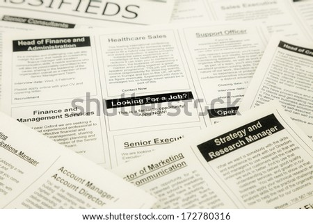 newspaper with advertisements and classifieds ads for vacancy, search for jobs - stock photo
