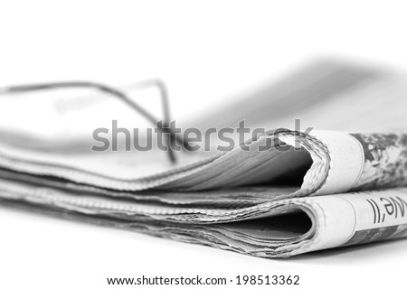 Newspaperfolded up on a white background - stock photo