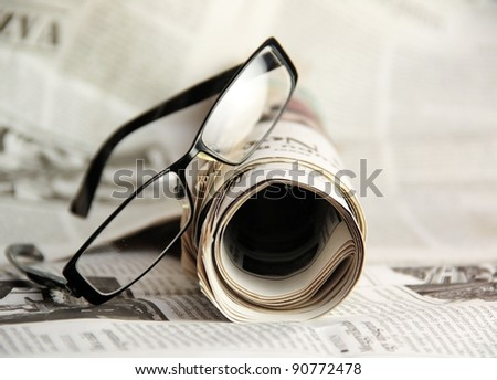newspapers and glasses - stock photo
