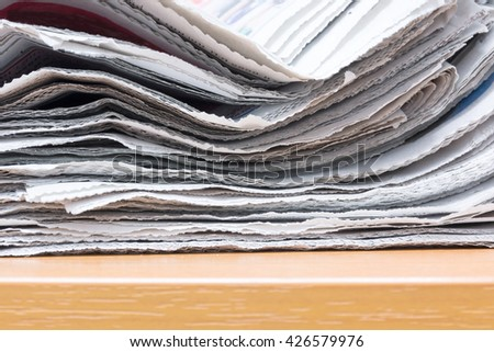 Newspapers folded and stacked. - stock photo