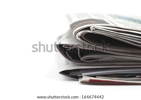 Newspapers folded, conceptual image for global communications, selective focus - stock photo