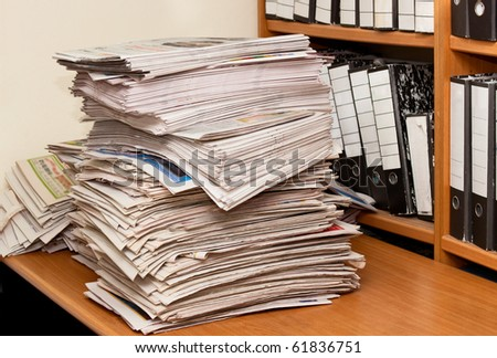 Newspapers isolated on desktop front of folders - stock photo