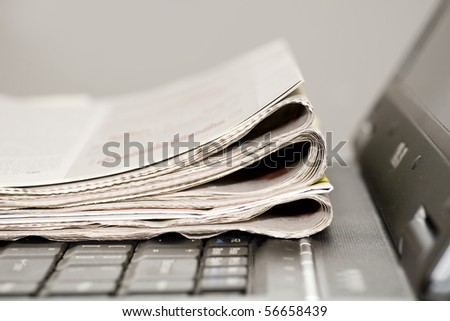 newspapers on the laptop - stock photo