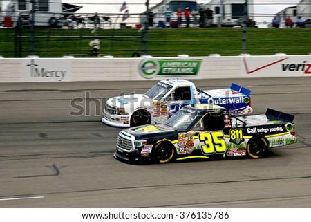 Newton Iowa, USA - July 11, 2014: NASCAR Camping World Truck Series, American Ethanol 200. Iowa Speedway. 35 Mason Mingus, Toyota, Win-Tron Racing - night racing - stock photo