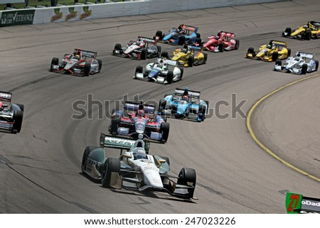 Newton Iowa, USA - June 23, 2013: Indycar Iowa Corn 250 race Iowa Speedway Ed Carpenter and field of Dallara race cars - stock photo