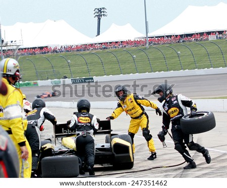 Newton Iowa, USA - June 23, 2013: Indycar Iowa Corn 250 race Iowa Speedway, pit stop Graham Rahal, Midas/Big O Tires Rahal Letterman Lanigan Racing, tire change and fuel - stock photo